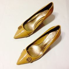 Coach nude heels Gold detail; lightly worn; size 5.5.  Short heel and great for the office.  Some minor scuffs along the side Coach Shoes Heels