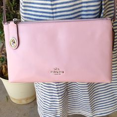 """Coach Crosby cross body bag in calf leather NWT Beautiful Coach pale pink Crosby cross body bag in calf leather. Two zippered compartments. Inside zip, cell phone and multifunction pockets. 22 inch strap drop for shoulder or Crossbody use.  9.75"""" x 6"""" x 2.5"""". NWT Coach Bags Crossbody Bags"""