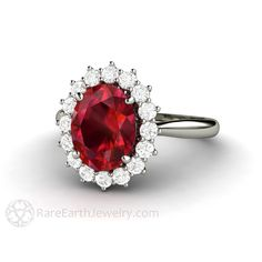Ruby Engagement Ring Ruby Ring Oval Cluster Halo Diamonds July Birthstone Red Gemstone Ring 14K or 18K Gold by RareEarth on Etsy https://www.etsy.com/listing/218806116/ruby-engagement-ring-ruby-ring-oval