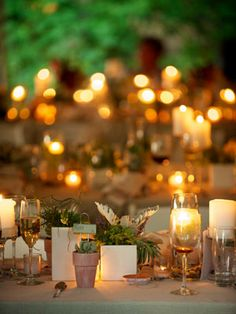 Set the Mood With Candlelight    We've yet to see a wedding with too many candles. Not only will tons of candles give you a soft, romantic glow, but placing them in containers at different heights adds instant dimension to your tables.