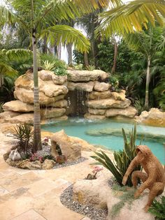 Tropical Style Pool With Natural Rock Waterfall