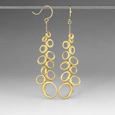 18k yellow gold, long dancing ovals. Ten Thousand Things @Quadrum