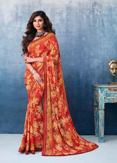 Orange Color Georgette Flower Printed Saree Product Details : Fabric of this casual wear saree is georgette. Comes along with a orange color raw silk unstitched blouse. Saree has flower design print. Ideal for casual wear or daily wear. Indian Designer Sarees, Indian Sarees Online, Latest Designer Sarees, Saree Sale, Orange Saree, Celebrity Gowns, Casual Saree, Georgette Sarees, Printed Sarees