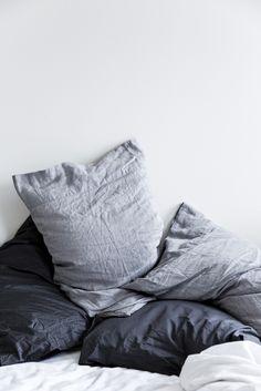 grey bed linens.