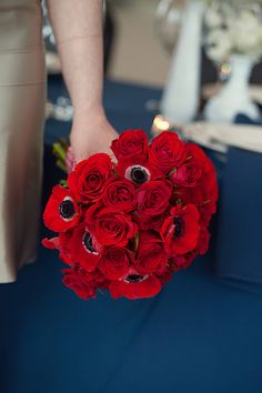 Love the twist to this classic Red Rose bouquet by adding red Anemones to it! For centerpieces??