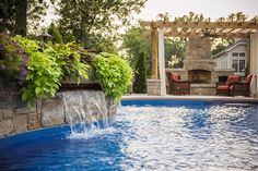Outdoor Fireplace with Pergola by Pool Water Feature | Landscaping Network