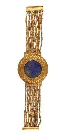 *EGYPT ~ Flexible bracelet - gold, lapis lazuli. Reign of Tutankhamun 1336-1327 BC. DISCOVERY SITE: Tutankhamun's tomb. | Photo (C) CULTNAT, Dist. RMN-Grand Palais / Ayman Khoury.