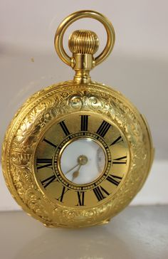 Lot #21:18kt Gold Antique  Pocket Watch with Exposed Movement