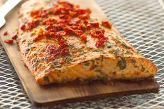 Cooking with a cedar plank infuses a delicious smoky flavor into the salmon. We'll show you just how easy it is!