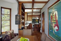 1936 California Spanish Colonial kitchen renovation. Mahogany cabinets, period light fixture and cabinet hinges, large commercial range with hood, mahogany floors, black granite counters. Source http://www.nealwardproperties.com/#gallery/740_Church/Kitchen/1