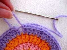 demonstrate, step by step, a technique to achieve a seamless join when crocheting in the round.