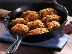 Unfried Chicken: After a quick dunk in hot-sauce-spiked buttermilk, boneless chicken thighs get a crunchy coat of corn flake crumbs and are baked to crispy perfection.