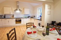 Sheep Pen enjoys open plan living with a fully fitted kitchen and dinning room with extra seating for guests