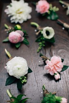 each boutonniere was unique, using flowers of the wedding including white ranunculus, white anemone, peach mini carnation,pink dahlia and pink ranunculus.