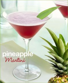 Pineapple Martini  1 oz. Pineapple Juice  1.5 oz. Vodka  .5 oz. Chambord    Shake ingredients with ice and strain into a martini glass.  Garnish with a wedge of pineapple or a pineapple leaf.    Sounds yummy!