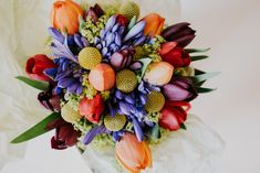 Beautiful photography of a bouquet of brightly coloured flowers for a bride at a wedding in the city centre of Manchester Floral Bouquets, Floral Wreath, Photography Ideas, Wedding Photography, Bright Colors, Weddingideas, Manchester, Centre, Table Decorations