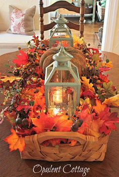 Basket centerpiece decorated with two blue color of the lanterns and fall leaf garlands.