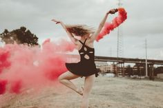 Dancer and Smoke bombs. Downton Baton Rouge, Louisiana urban ballet and modern dance shoot. Baton Rouge creative environmental and lifestyle portraits. Photo by Christi Childs