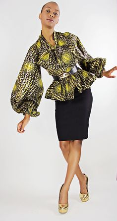 The Naomi -African Print 100% Holland Wax Cotton/Metallic Shirt. $93.00, via Etsy.