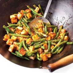 Szechuan Tofu & Green Bean Stir-Fry Recipe: only 218 calories and packed with 12 grams of protein--even though it's a vegetarian dish!