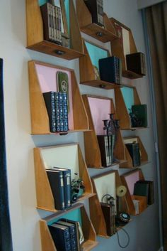 Old drawers cut down at the back, bottoms painted or papered, hung on wall. Make a large arrangement as shown, for books or to display your favorite things...or hang just a few. Very practical use for old drawers.