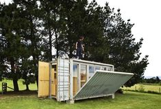 Cargo container unfolds to reveal cleverly appointed weekend house via Gardenista