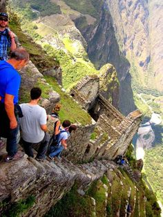 Huayna Picchu is a mountain in Peru which rises about Machu Picchu, the so-called lost city of the Incas. A steep and, at times, exposed pathway leads to the summit which is 850 ft. higher than Machu Picchu. Machu Picchu, Huayna Picchu, Places Around The World, Travel Around The World, Around The Worlds, Places To Travel, Places To See, Travel Destinations, Scary Places