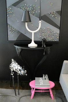 """Give your living room a budget-friendly update by painting flea market finds, like this table done in Glidden paint's """"Onyx Black"""" and stool in """"Sexy Pink."""" Via @TheDesignerPad for MyColortopia.com."""