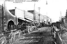 """This early scene of the Wilson Tobacco Market show farmers lined up along Goldsboro Street to unload their tobacco for sale at a local warehouse. The photo was taken by O.V. Foust, Wilson's leading photographer during the early years of the 20th century. The Wilson Times is publishing historical photos of Wilson County life and landmarks in this space each day. To share your snapshots, email the picture and caption to Lori Parrish at lori@wilsontimes.com with the subject line """"Remember When""""…"""