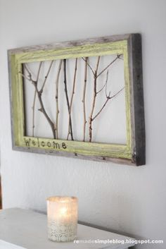 maybe put some sand dollars hanging in a frame instead of the branches