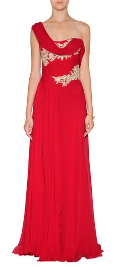 Radiant in scarlet silk, Marchesa's embellished evening gown features shimmering metallic gold embroidery and a stunning drape #Stylebop