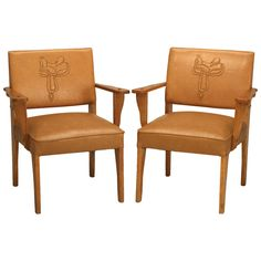 "1stdibs | Magnificent Pair of Original ""Ranch Oak"" Cowboy Arm Chairs w/Saddle Decoration"