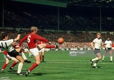 Captain Bobby Moore of England clears the ball during the World Cup Final between England and West Germany at Wembley Stadium on July 1966 in London, England. Bobby Moore, Wembley Stadium, World Cup Final, Finals, Champion, Germany, England, Boys, World Football