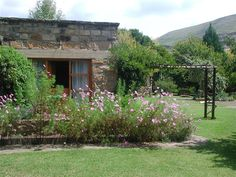 Timmerskraal Private Sandstone Guest House nestled in the picturesqueness town of Clarens. A tribute to old fashioned country cottage style living, Outside Seating Area, Pet Friendly Accommodation, Self Catering Cottages, Entrance Ways, Cottage Exterior, Bbq Area, Lounge Areas, Large Flowers, B & B