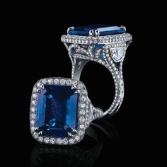 An Impressive 10 Carat Emerald Cut Sapphire. This Burma sapphire is mounted in a handmade platinum ring with half moon cut diamonds in the American Glamour style. -Robert Procop Exceptional Jewels