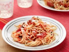 Try this easy go-to recipe for Simple Spaghetti with Tomato Sauce and you'll never buy jarred sauce again. Look for canned San Marzano plum tomatoes--they are slightly sweeter and less acidic than other varieties.