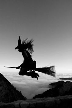 riding her broom