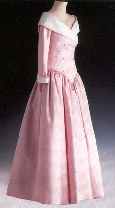 by Catherine Walker. Pink satin with white raw silk on collar and cuffs. Diana's wore this dress to the in 1987 and on an official visit to Germany also in 1987,  in 1988 to a film premier, for a dinner for the President of Turkey in 1988 and to a formal banquet for the President of India in 1990.  Diana also chose this gown for an official portrait with Prince Charles.  $28,750.00 Purchased by Melissa Downey Scripps, St. Marten, British Virgin Islands