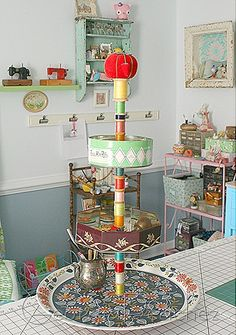 Caddy for sewing studio made from vintage tins on a lazy susan. - Gorgeous! Making something similar for my bathroom counter this weekend. :)