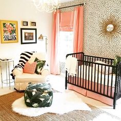 So much to love in this gorgeous nursery! Bold wallpaper, palm leaf fabric accent and a classic crib in black, we can't pick a favorite.