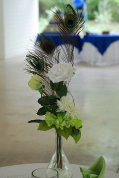 Peacock Feather Centerpieces - silk flowers & candles :  wedding arrangements blue candles centerpieces feather floral flowers glass green ivory peacock reception tea lights votives white CLAdCenterpiecClose