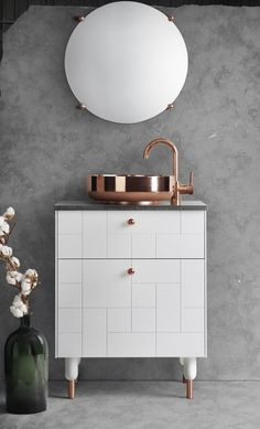 white superfront bathroom cabinet with copper sink