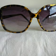 Cheetah Print Sunglasses With Square Frames Gold and black cheetah print sunglasses. Never worn. LOFT Accessories Sunglasses