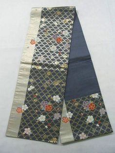 "This is an opened Nagoya obi with ""Sakura""(cherry blossom) on 'kagome' (woven bamboo) pattern, which is woven"