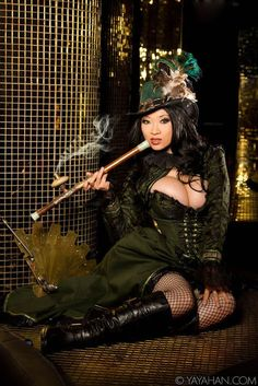 Shanghai Steampunk Madam (with steampunk folding fan and opium pipe) in green - For costume tutorials, clothing guide, fashion inspiration photo gallery, calendar of Steampunk events, & more, visit SteampunkFashionGuide.com