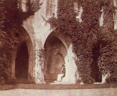 The Reverend Calvert Jones in the cloisters of Lacock Abbey, c 1843. Calvert Richard Jones (1802-1877) was a friend of Talbot's and worked with him on the production of calotype negatives to produce prints for commercial sale. Lacock Abbey in Wiltshire, now open to the public and housing a photography museum, was Talbot's family home.