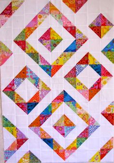 Canton Village Quilt Works: Diamonds In The RoughHalf Square Triangle Block Quilt Pattern - I keep coming back to this particular pattern after all the ones I've come across.hst - this would be great for all my leftover kaffe scrapsA super scrappy wa Half Square Triangle Quilts Pattern, Half Square Triangles, Square Quilt, Scrappy Quilts, Easy Quilts, Mini Quilts, Quilt Block Patterns, Quilt Blocks, Chevron Quilt Pattern