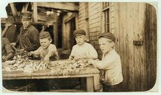 Three young cutters who work in Seacoast Canning Co., Factory #4. Ages 10 to 12. Work regularly. Location: Eastport, Maine.