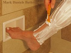 inset soap dish at knee height for foot rest in shower  shower-shelf.com