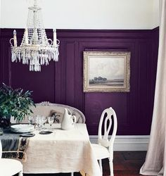 white with one accent wall. Possibly a deeper purple (brighter flowers on the table)